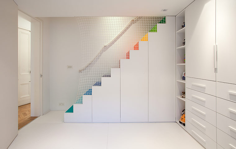 Children's room with differently coloured stairs